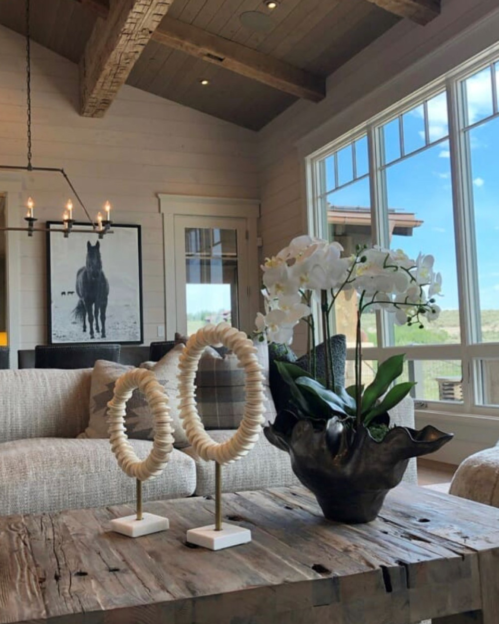 Dining table with orchid and art